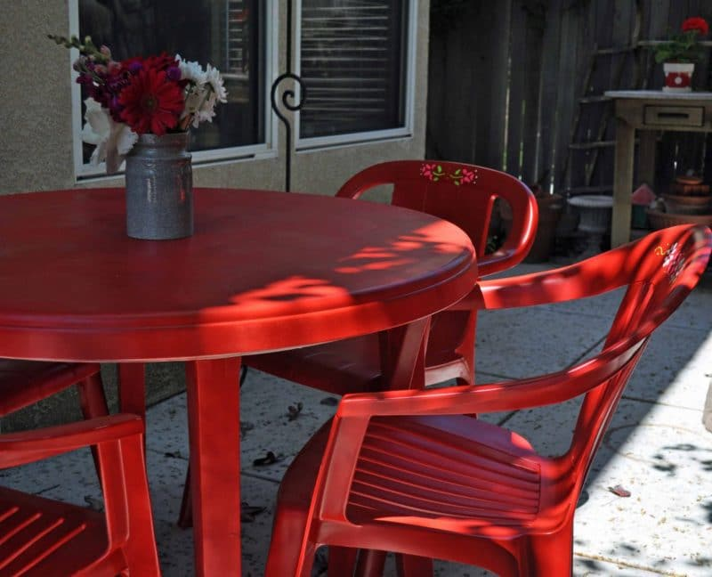 painted red furniture. plastic patio furniture painted red