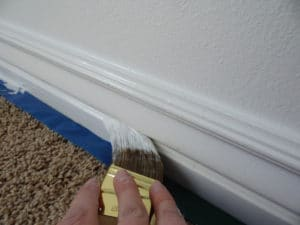 painting-trim-with-paint-brush