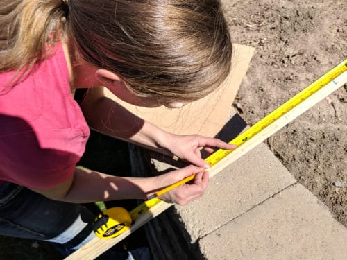 measuring frame pieces for DIY project home decor