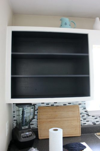black kitchen shelving open cabinets