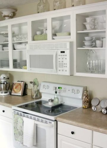 open shelving around microwave kitchen cabinets