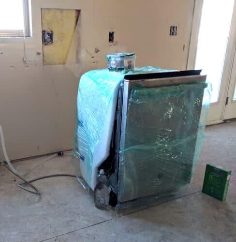 covered dishwasher during remodel