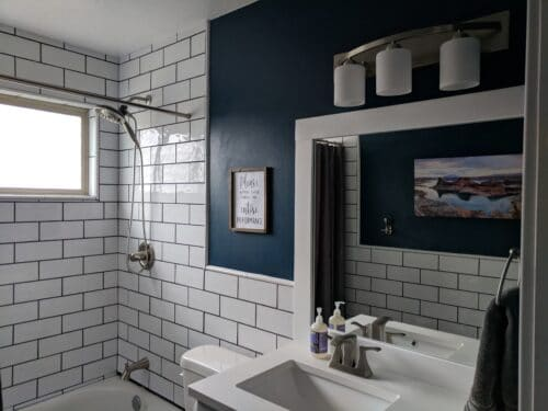 bathroom with tile on walls