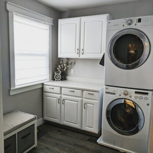 laundry room with repainted cabinets